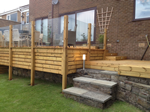 Recent fitting of garden decking in New Mills